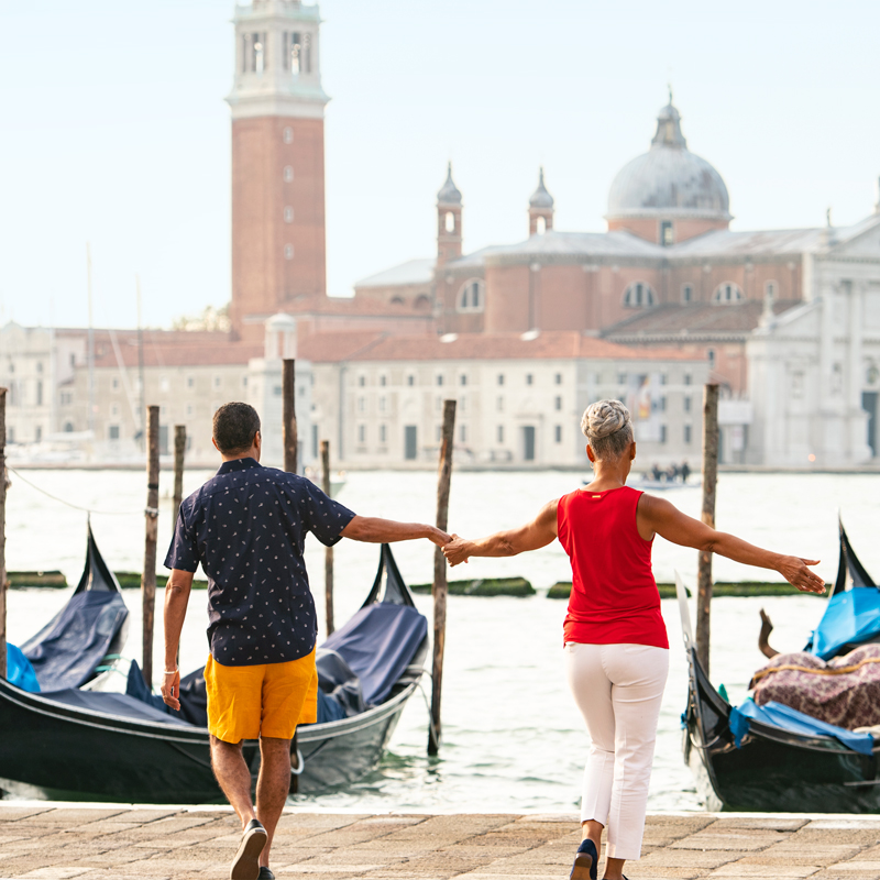 Couple standing on dock in Venice, Italy